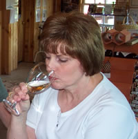 Shirley Mabe noses a white wine